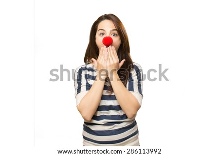 Surprised woman with clown nose. Over white background - stock photo