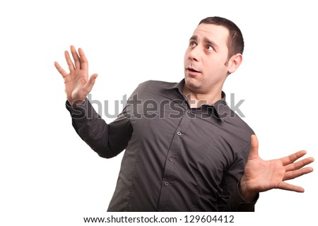Surprised young businessman - stock photo