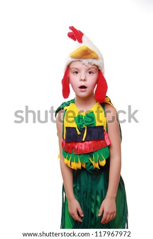 Surprised young girl in costume of rooster on Holiday theme