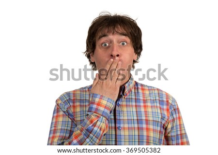 Surprised young man covering mouth isolated on white background. - stock photo