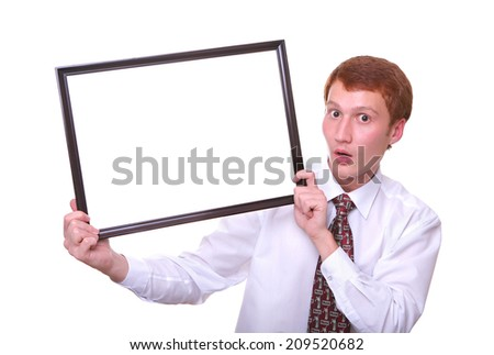 surprised young man holding a frame isolated on white