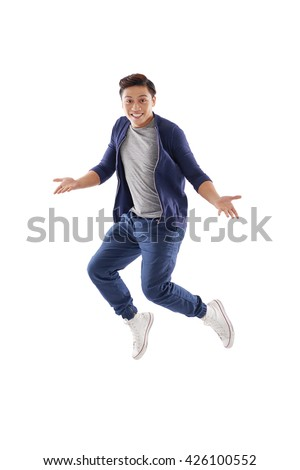 Surprised young man jumping, isolated on white - stock photo