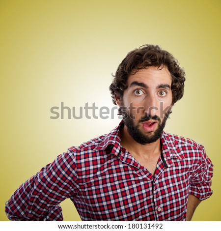 Surprised young man over orange gradient background