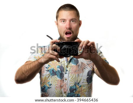 Surprised young man taking a picture isolated on white background