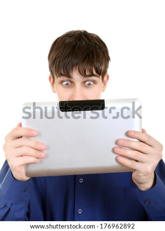 Surprised Young Man with Tablet Computer Isolated on the White Background