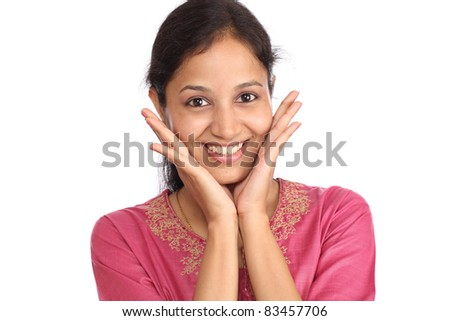 Surprised young woman against white - stock photo