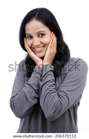 Surprised young woman against white background  - stock photo