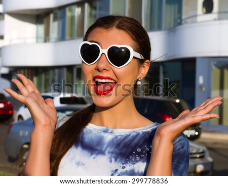 Surprised young woman in glasses.Cheerful girl winner shocked over winning with funny joyful face expression.Happy girl excited.Beautiful mixed race student smiling with open mouth and open palms - stock photo