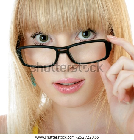 Surprised young woman in glasses isolated over white background