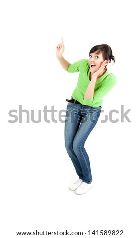 surprised young woman in green blouse showing something up, full length, white background