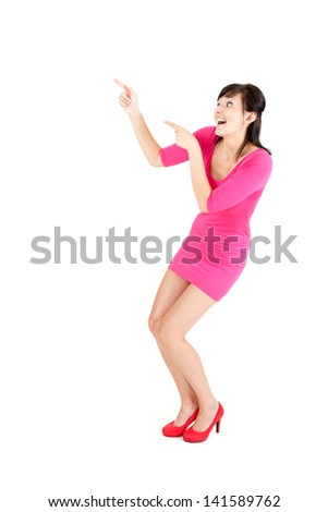 surprised young woman in pink dress showing up, full length, white background
