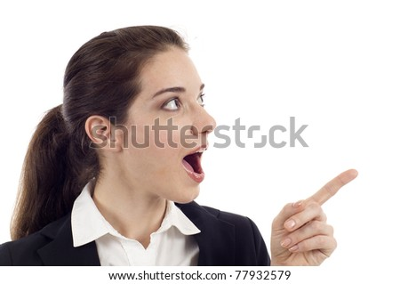 Surprised young woman pointing at copy space, looking up isolated over white background - stock photo