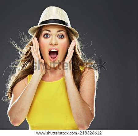 surprised young woman portrait . studio background. hands touching face. - stock photo
