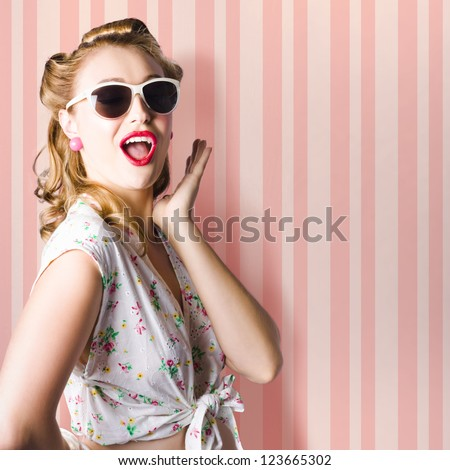 Surprised Young Woman With Pinup Hair Style And Makeup Posing In Striped Copy Space Retro Studio - stock photo