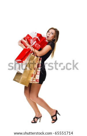 surprised young woman with shopping bags and gifts. isolated on white - stock photo