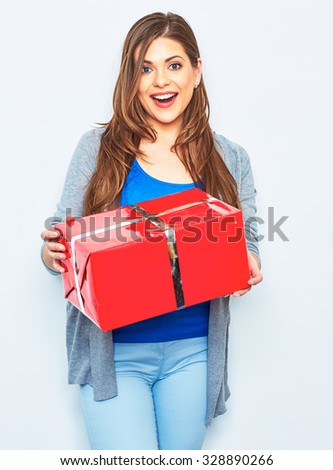 Surprising Woman hold big  gift box. Big smile with teeth. Emotion of happy woman. White wall background. Red gift box.  - stock photo