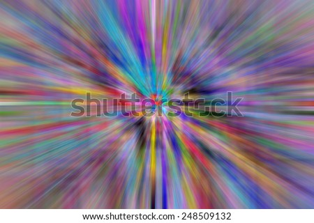Surreal abstract of multicolored streaks like so many rays with radial blur caused by travel at high velocity - stock photo
