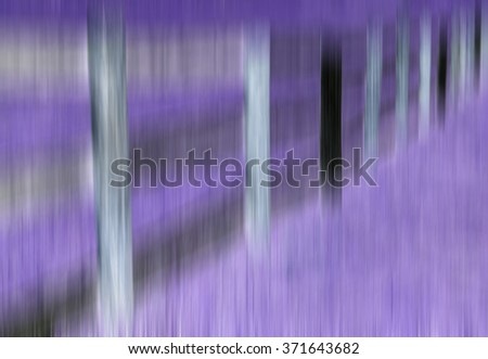 Surreal abstract of paddock fence with much violet and vertical motion blur, for illustration or background with motifs of rusticness, dreams or memories, perception - stock photo