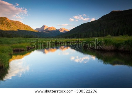 Surreal blue reflection in the Uinta Mountains, Utah, USA.