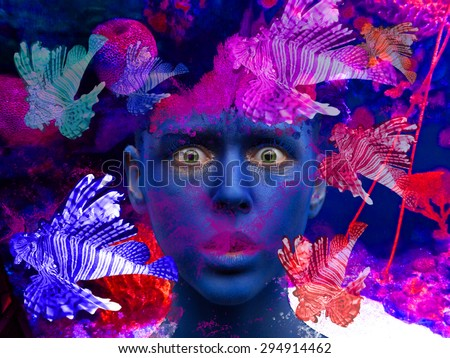 Surreal inspiring portrait of a woman sea ocean mermaid nymph with glowing eyes and surprised glance surrounded by bright tropical fish. Digital photo collage. Androgenic Underwater world creature - stock photo