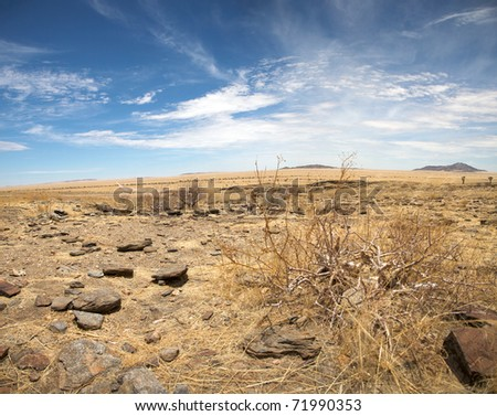Surreal panorama of the Namib desert going towards solitaire and sossusvlei - stock photo