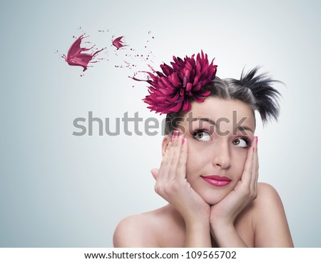 surreal portrait of a young beautiful woman with red flower on her hair dreaming - stock photo