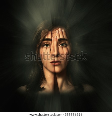 Surreal portrait of a young girl covering her face and eyes with her hands.Double exposure - stock photo