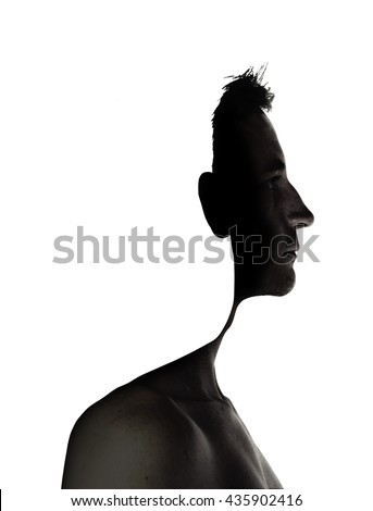 surrealistic portrait of a young man with cut out profile