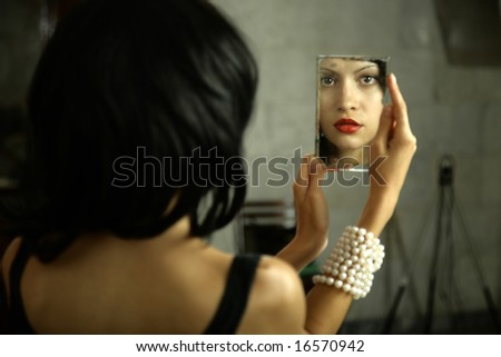 Surrealistic portrait of young lady with mirror. Fashion photo - stock photo
