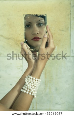 Surrealistic portrait of young lady with mirror. Fashion photo
