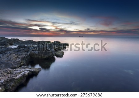 surrealistic sky in combination with a mirror surface of ocean - stock photo