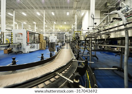 SURREY, CANADA-NOVEMBER 29, 2013:Beer production lines are part of the Central City Brewers + Distillers' new 65,000 sq.ft. state-of-the-art brewery and distillery in Surrey, BC, Canada, Nov.29, 2013. - stock photo