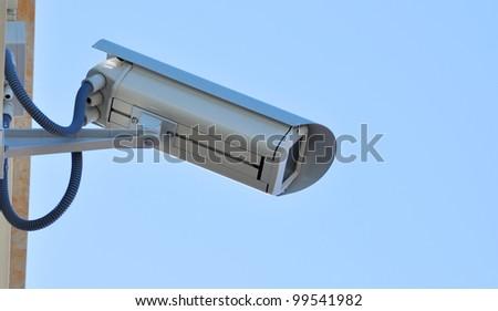 Surveillance cam watch right - stock photo