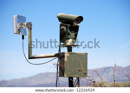 Surveillance camera at the border to prevent illegal immigration - stock photo