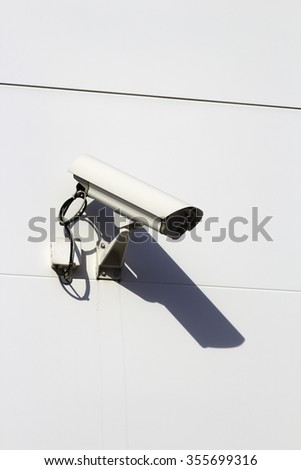 Surveillance camera on building exterior