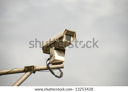 surveillance camera on pole