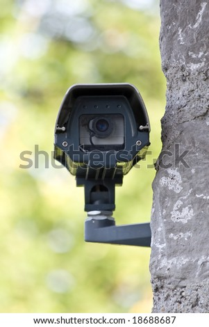 Surveillance camera on the wall - stock photo