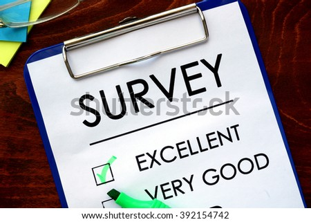 Survey written in a notebook. Marketing concept. Excellent. - stock photo