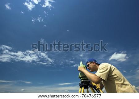 Surveying under blue sky. - stock photo
