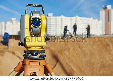 Surveyor equipment tacheometer or theodolite outdoors at construction site - stock photo