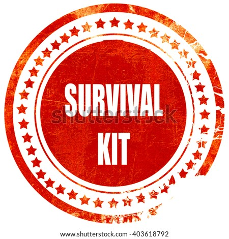 Survival kit sign, grunge red rubber stamp on a solid white back