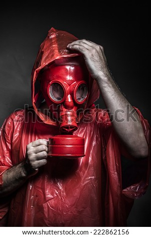 survival nuclear concept, man with red gas mask - stock photo