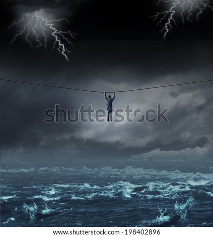 Surviving the storm business concept with a businessman hanging on to a tightrope crossing over dangerous water as a concept and metaphor for conquering adversity and overcoming challenges. - stock photo