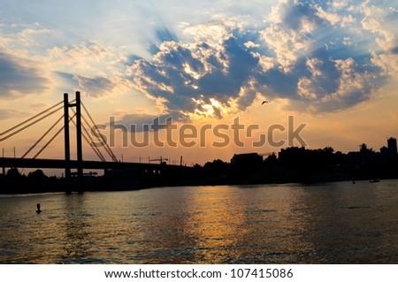 Suset over the rail bridge - stock photo