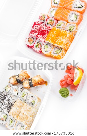 Sushi and roll set in plastic box, closeup on white