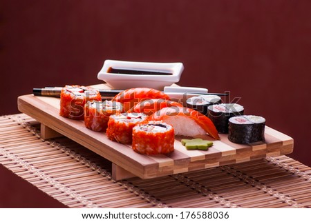 sushi and rolls on a bamboo geta - stock photo