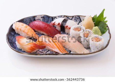 Sushi asian fish food realistic set with plate chopsticks and spices isolated on white background