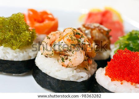 Sushi Canape with eel, shrimp, tobiko caviar, wasabi and salmon close-up - stock photo