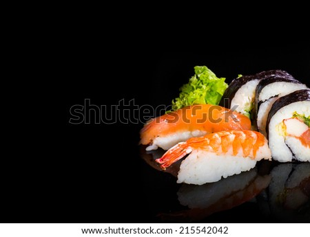 Sushi collection, isolated on black background. - stock photo