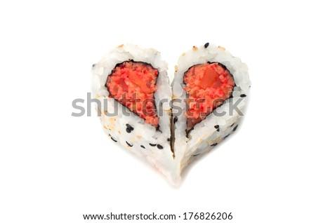 Sushi forming heart shape on white background - stock photo